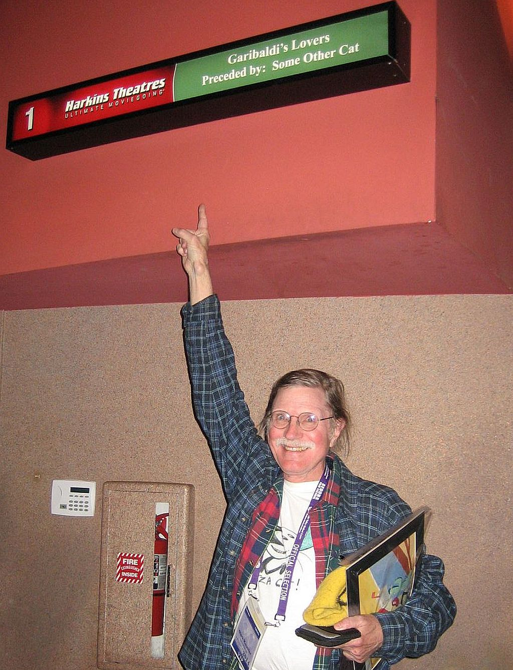 sedona-mark-pointing-at-marquee.jpg